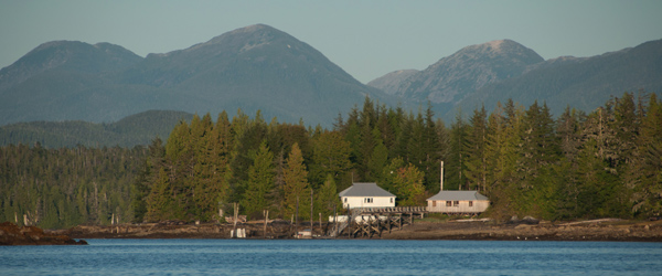 Raincoast's field station in Bella Bella in front of a backdrop of forest and mountains