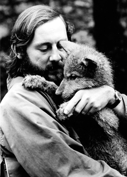 Dr. Paul Paquet holding a wolf pup. This picture was taken in 1973.