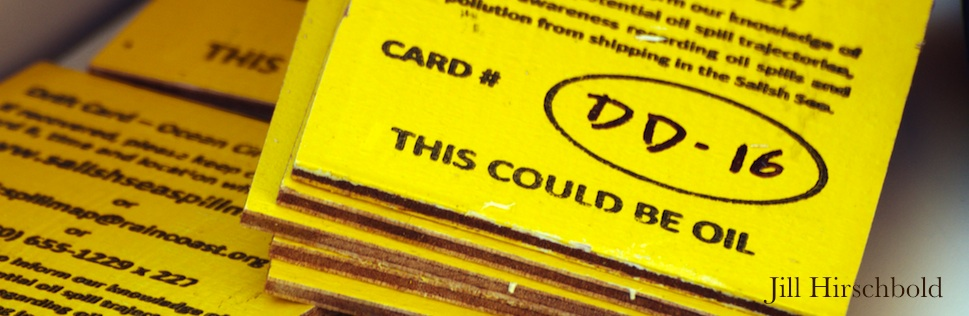 """A stack of drift cards with the message """"this could be oil"""""""