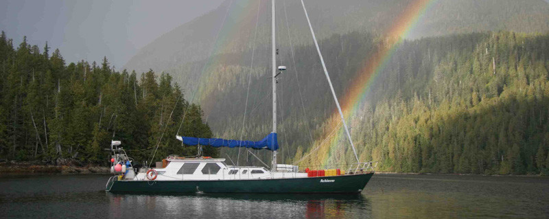 Achiever, on the coast with a rainbow in the background.