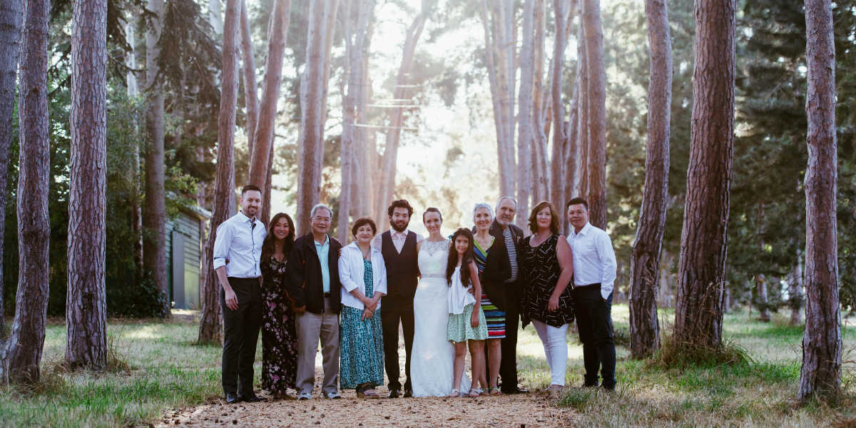 Victoria couple, Laylí and Niño, with their family on their wedding day
