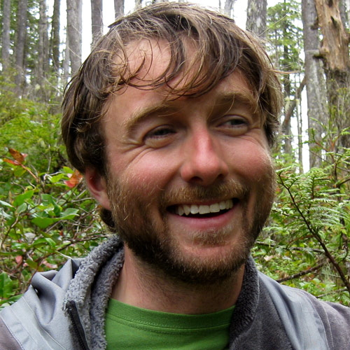 Kyle Artelle, PhD, smiles broadly in the Great Bear Rainforest.