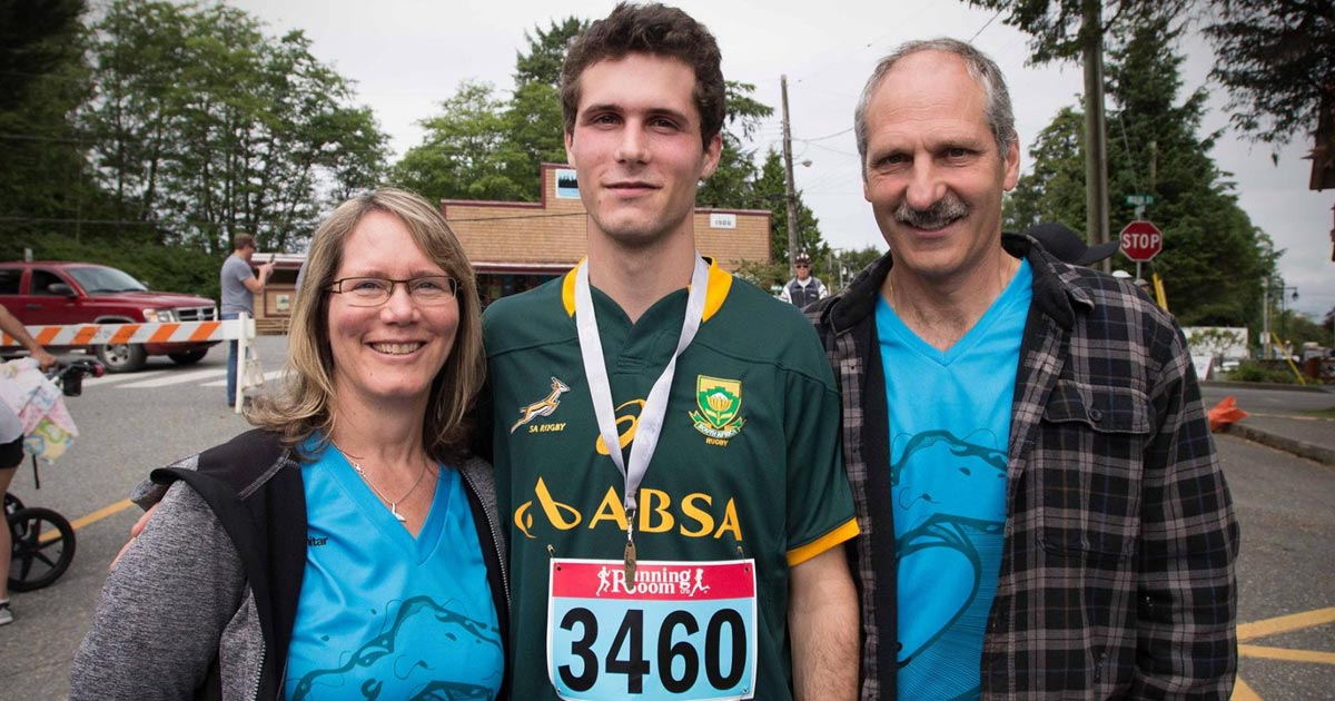 Giordano Corlazzoli and his parents stand together after a marathon.