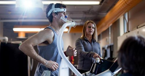 Gio runs on the treadmill with a CO2 mask testing his oxygen uptake.