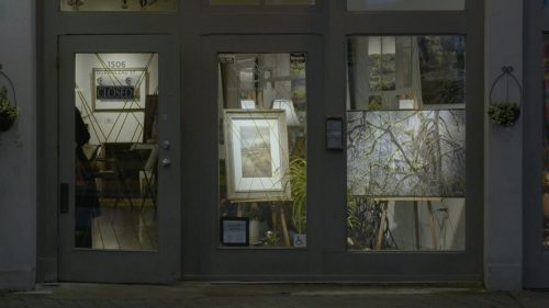 The Karen Cooper Gallery has a light on and the store is full of beautiful pictures.