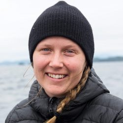 Megan Adams, applied conservation science lab, UVic, out on the Salish Sea, in a black toque.