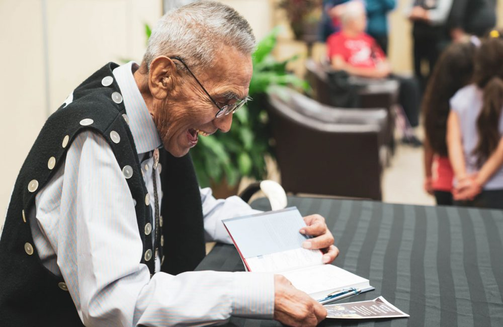 Cecil Paul, Xenaksiala elder, at a book signing in Kitimat Valley.