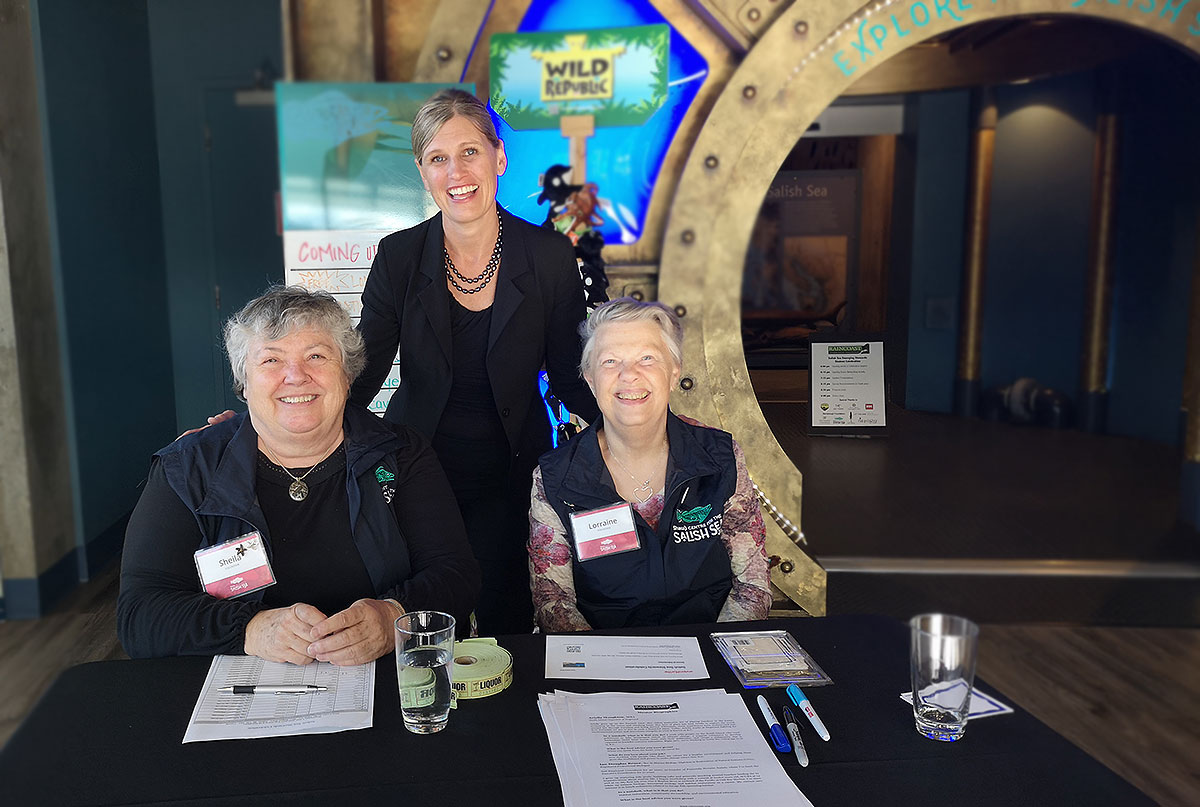 Volunteers and manager with the Shaw Centre for the Salish Sea