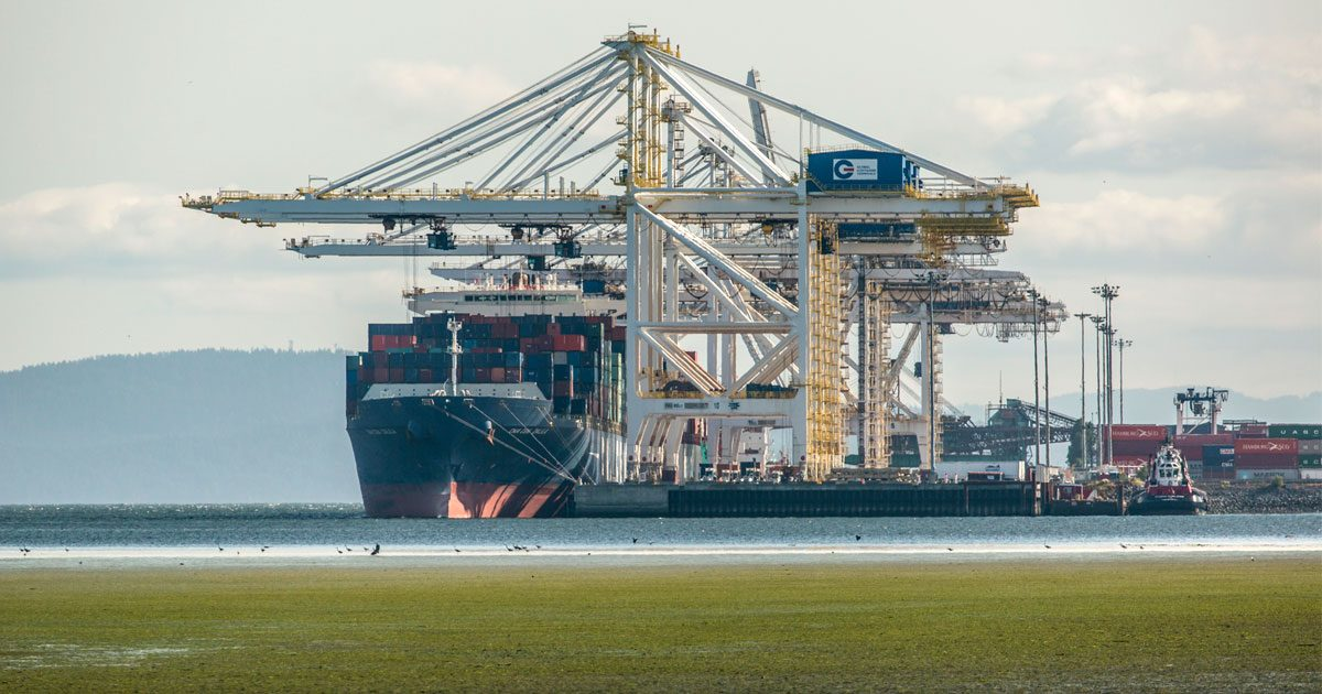 A container ship get loaded at a terminal near Vancouver.