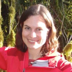 Heather Bryan in the forest, smiling.