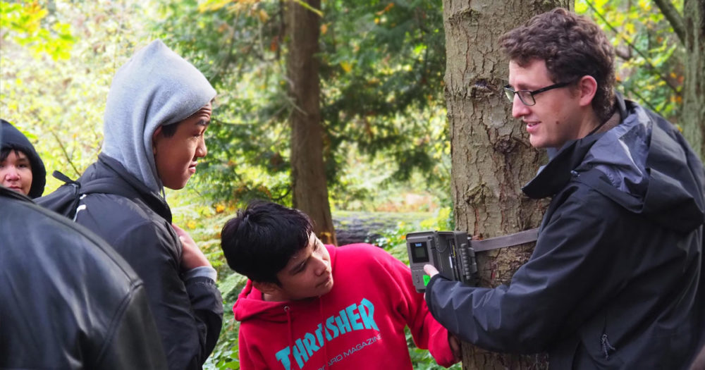 Tyler Jessen helps some young Salish Sea Emerging Stewards on campus to examine a remote sensing device.