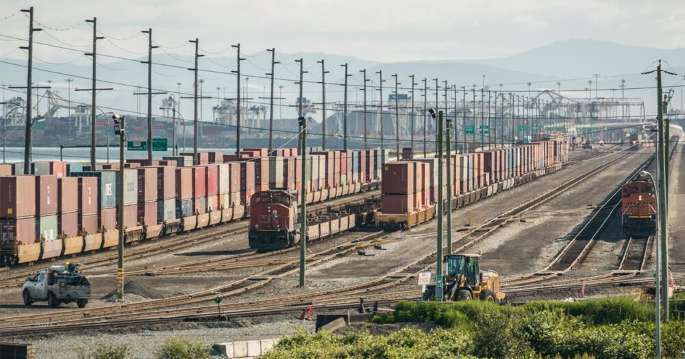 The trains and containers on the causeway to Terminal 2.