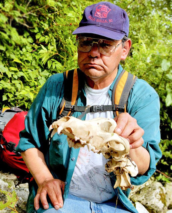 Chester Starr holds a wolf skull up for examination.