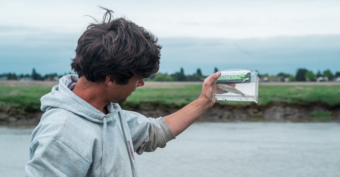 Dave Scott holding viewfinder with salmon smolt