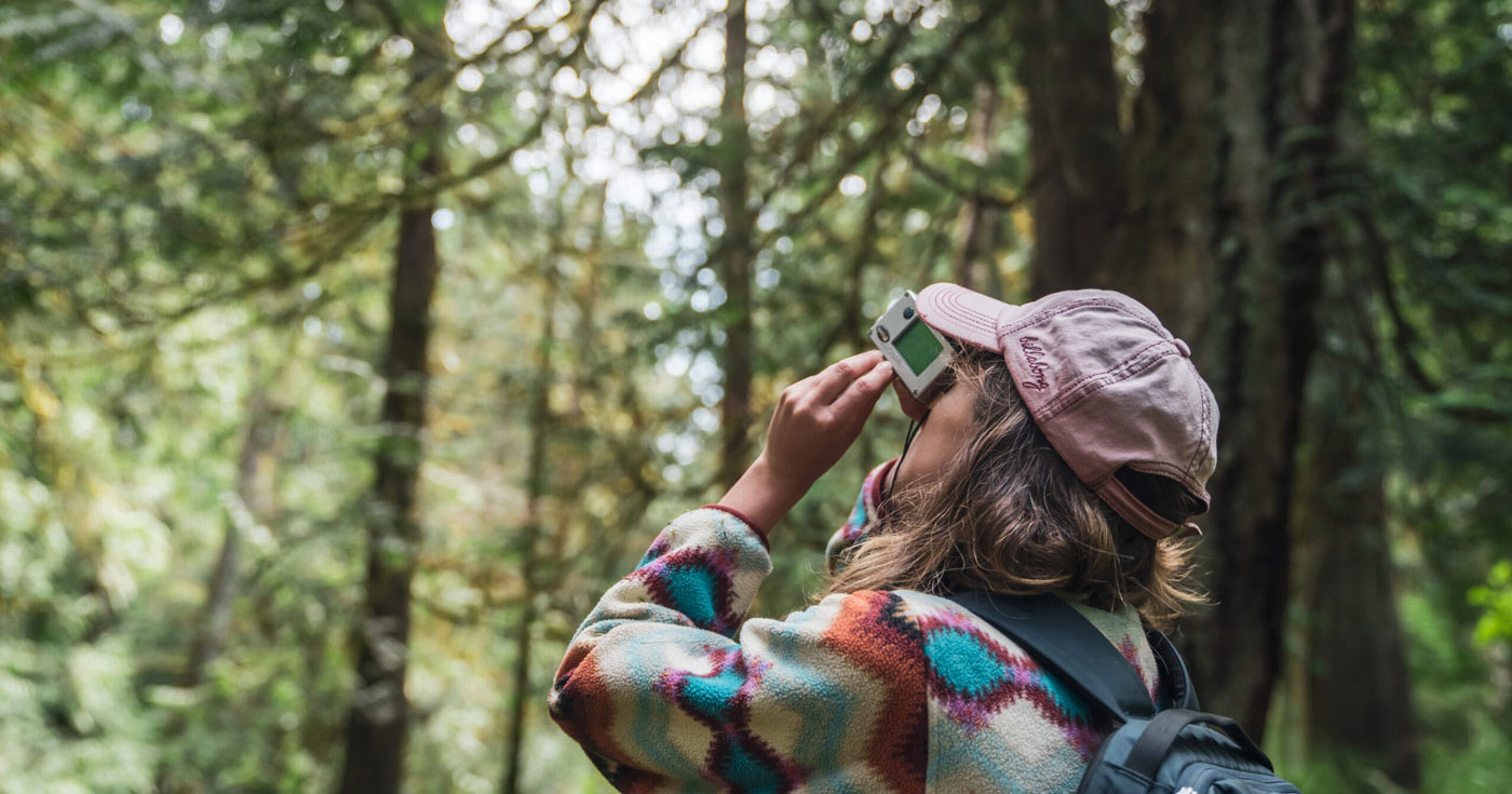 Shauna Doll measures a tree in the Gulf Islands.