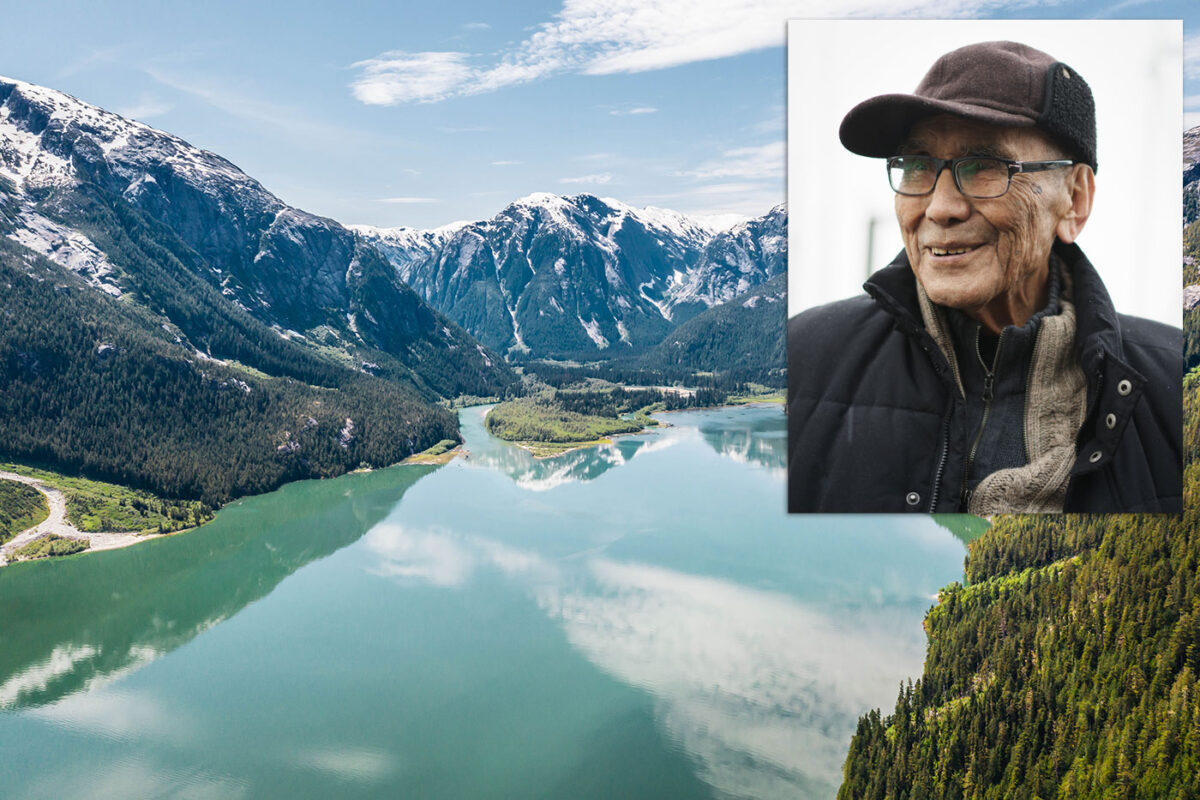 Cecil Paul profile, smiling, floating over the Kitlope.