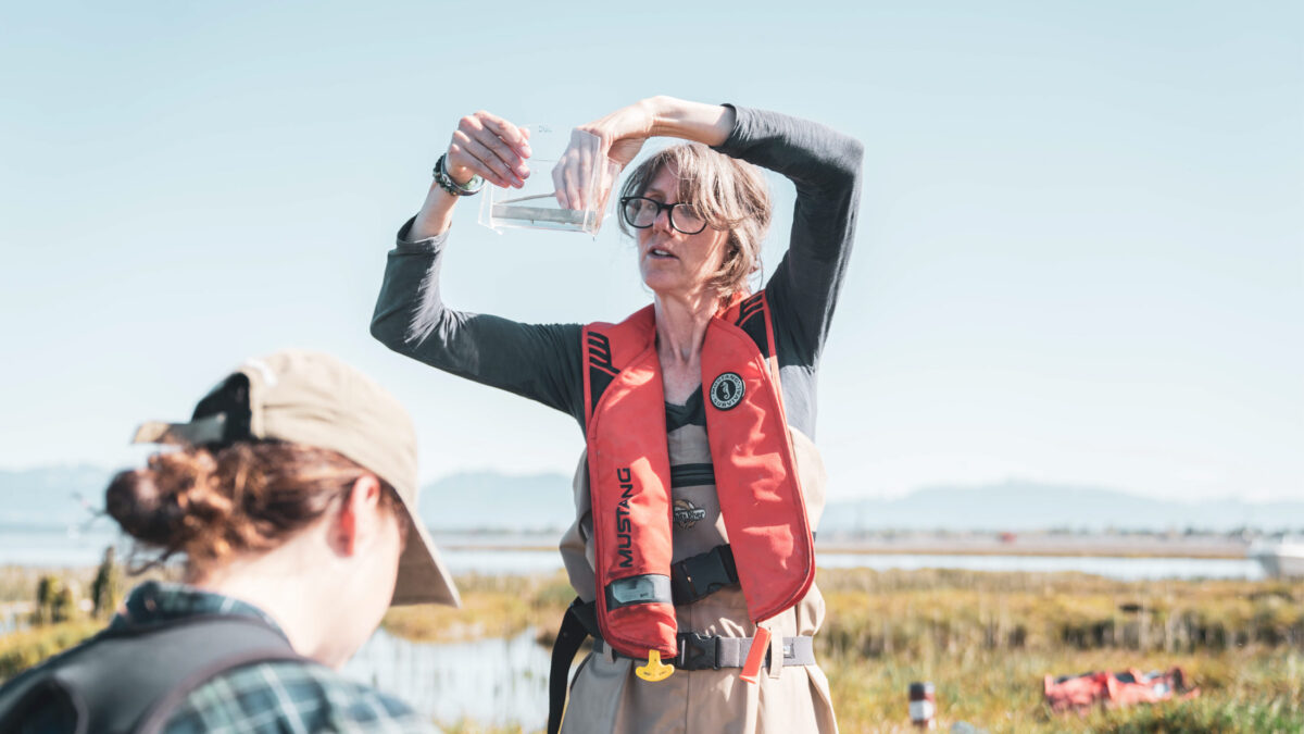 Misty MacDuffee and the field team assess salmon in the Fraser Estuary.