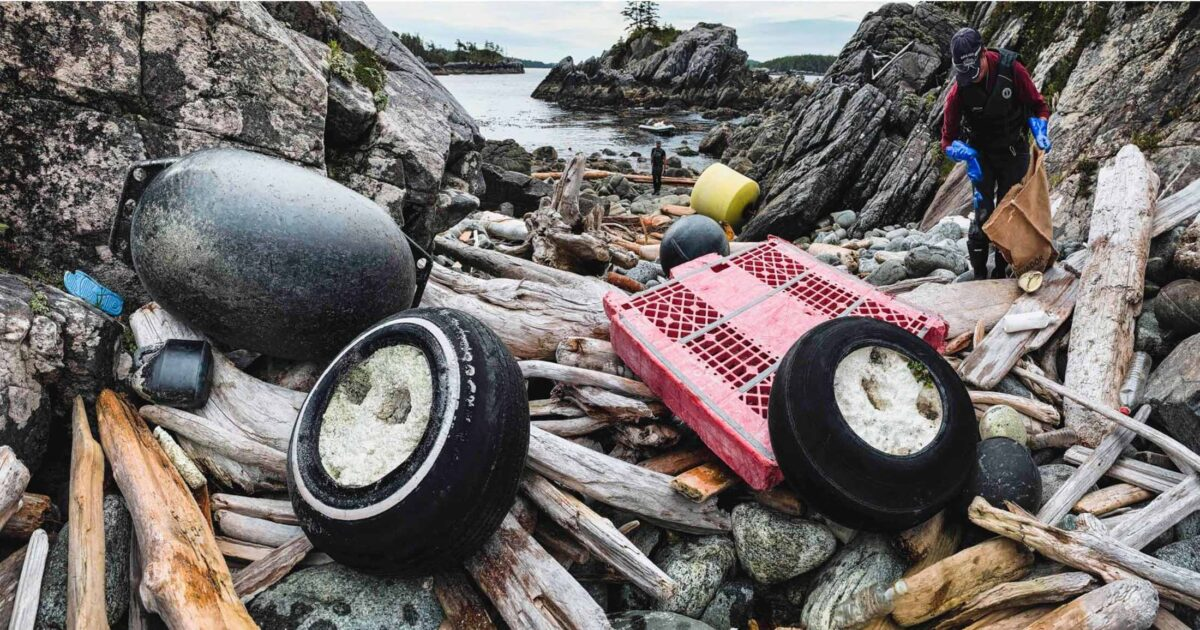 Lots of garbage on a beach.