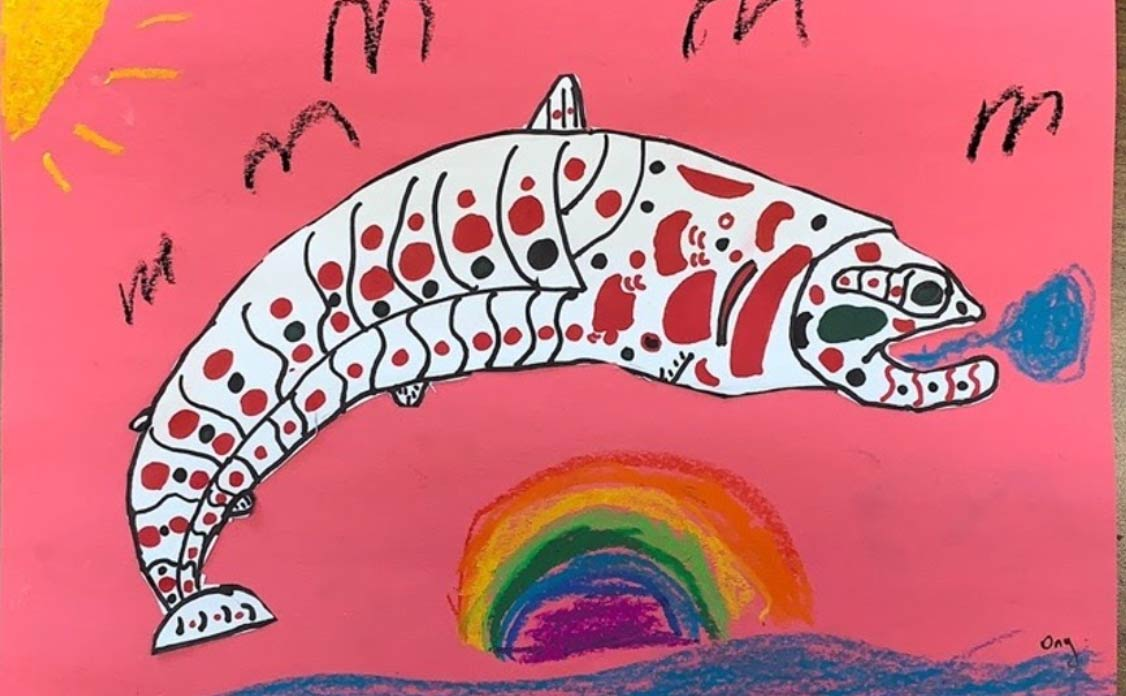 Children's drawing of a salmon jumping over a rainbow.